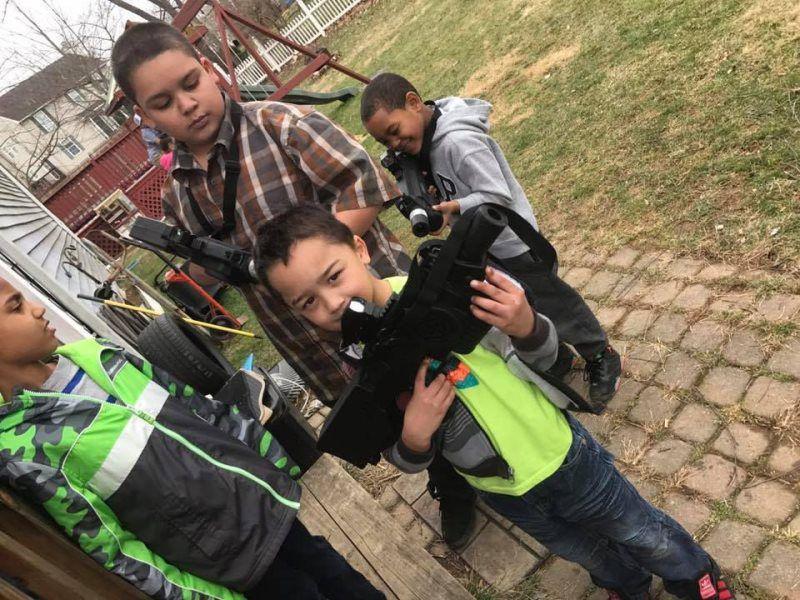 kids holding playing gun