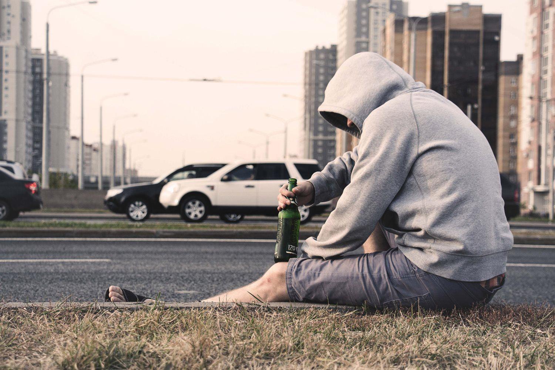 man drinking alcoholic drinks