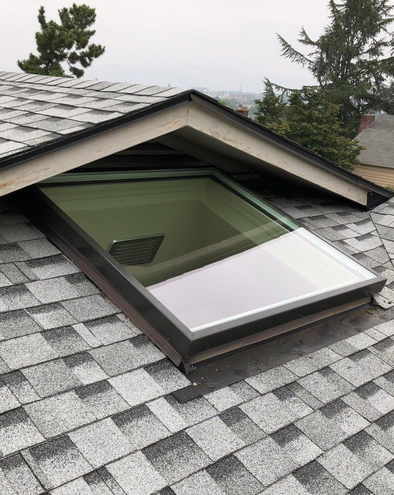 roof view of skylight installation surrounded by roof tiles