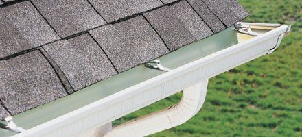 upclose view of white gutter installation