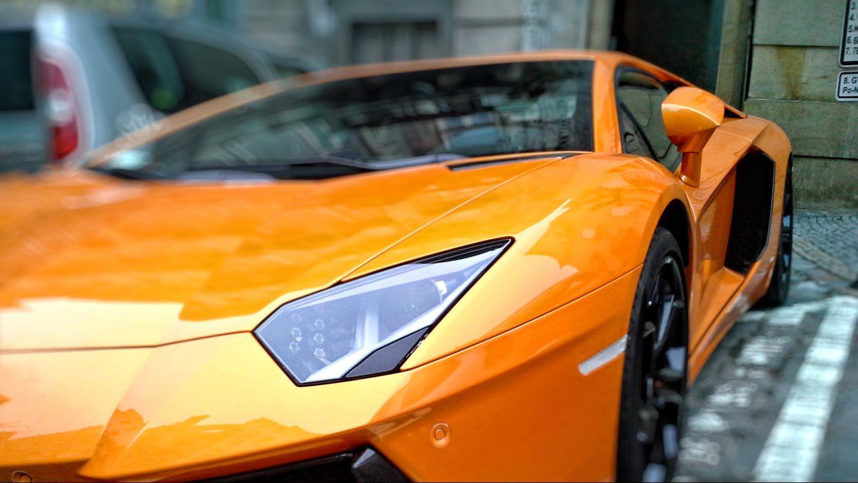 yellow orange sports car