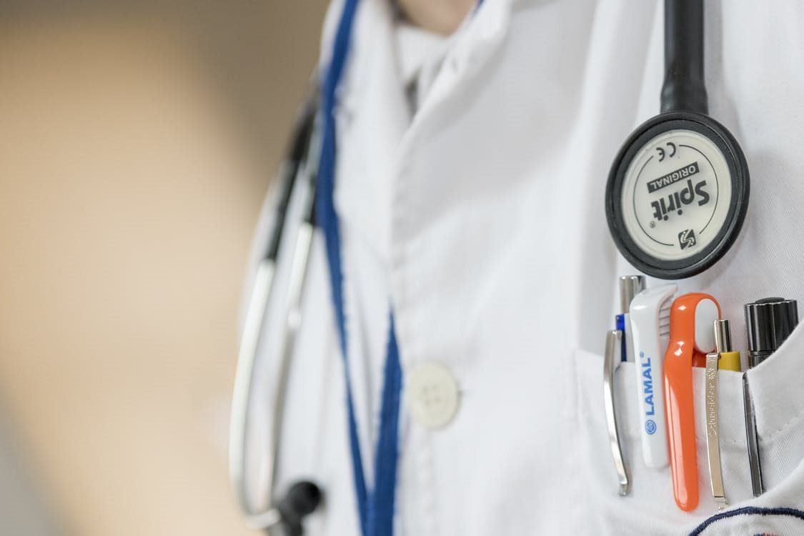 stethoscope and pens