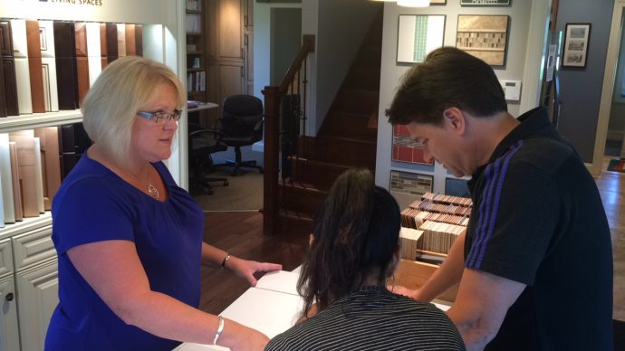 kathy barthauer helping customers in showroom.png