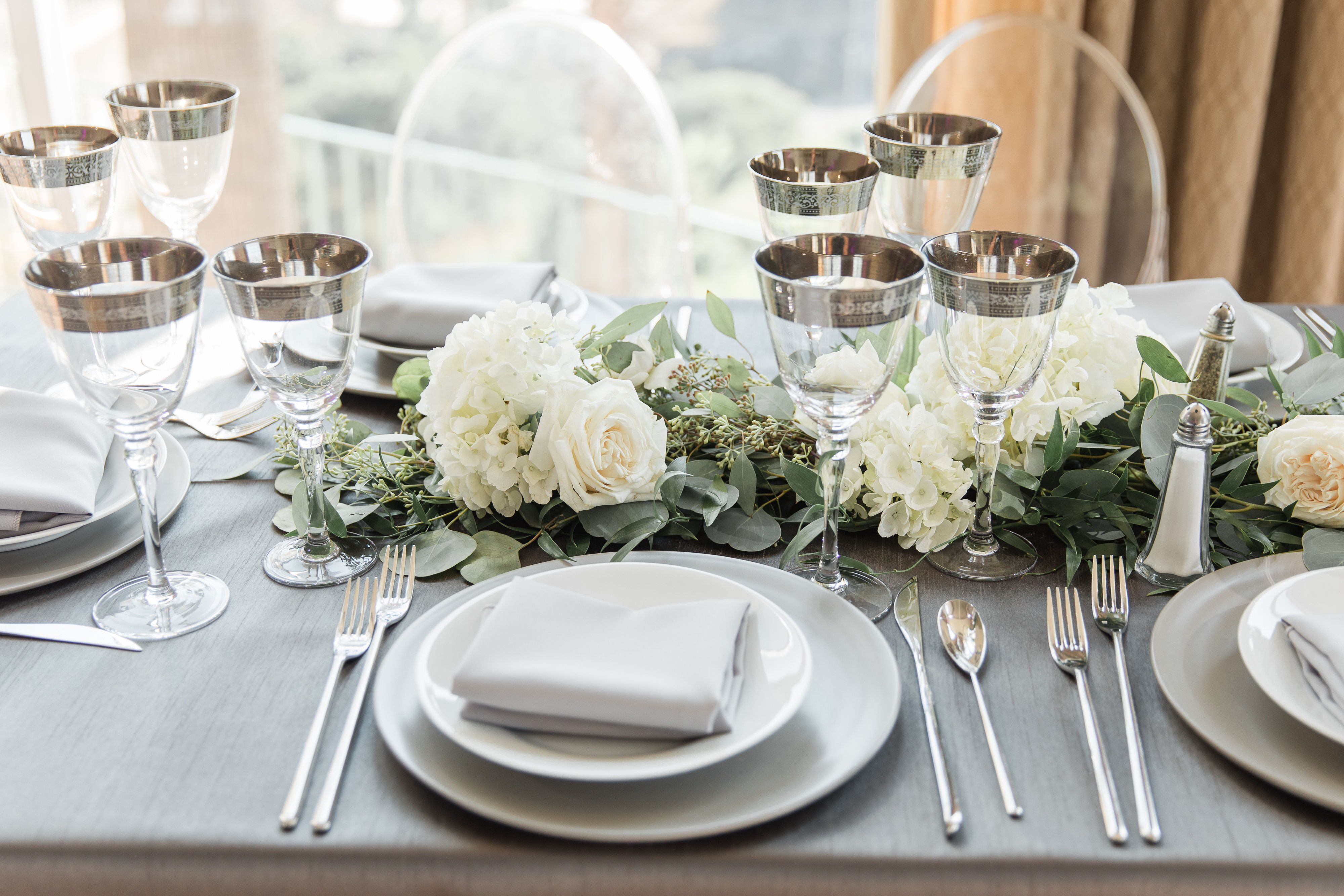 white roses with glasses and plates