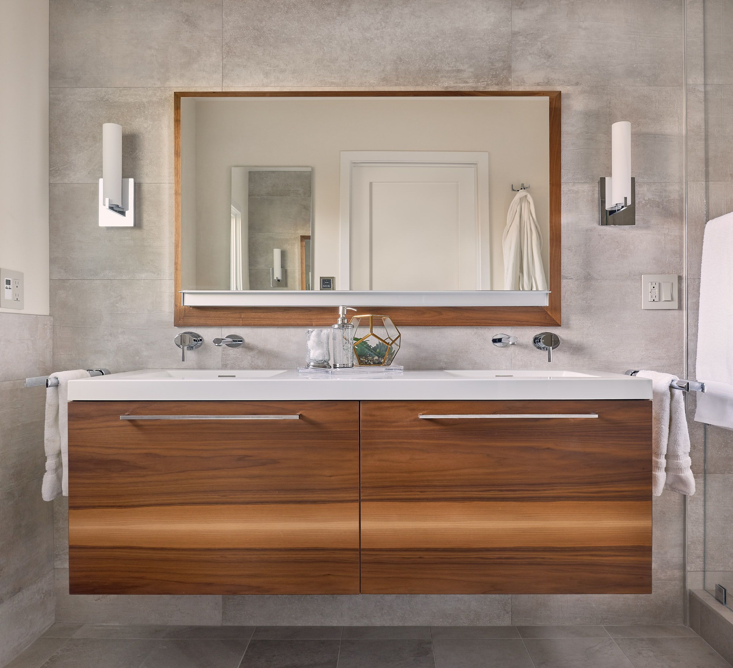 Bowed Vessel Sinks Hug And Soften Weighty Rectilinear Shapes Black Free Standing Vanities Mirror Frames Enrich The Sleekness Of Design