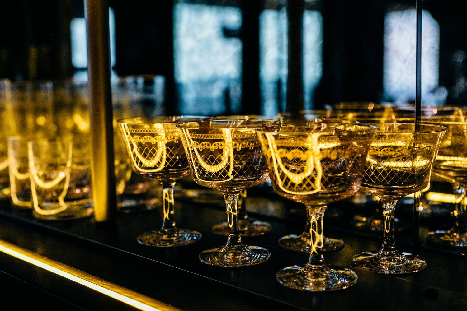 Glasses lined up at the bar