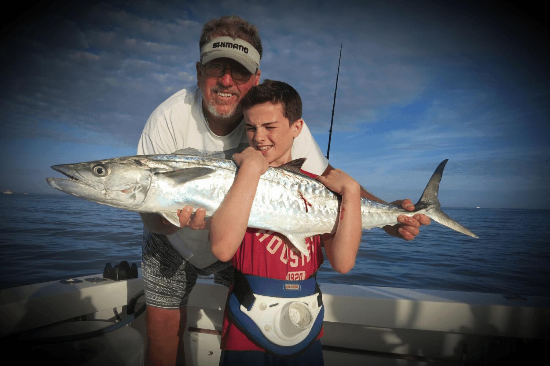 Men catches fish